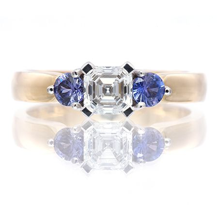 Three-stone Ring with Centre Asscher Diamond and Round Sapphire Side Stones
