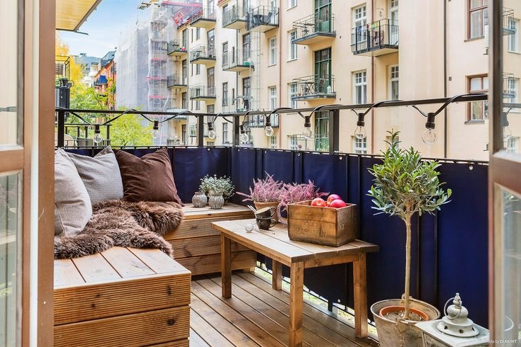 Small Parisian patio with blue privacy screen on balcony.
