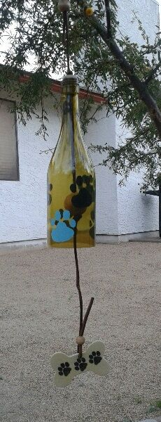 This recycled wine bottle chime will brighten up any deck or patio. You will love the sound, and the look with its hand painted dog paws. by WaggyPawChimes on Etsy