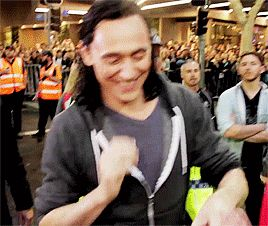 """lokihiddleston: It's like really Loki in Midgard, smiling with one of those sweet smiles. And he is """"happy"""" Gif-set: http://maryxglz.tumblr.com/post/161692469527/lokihiddleston-tom-hiddleston-on-the-set-of"""