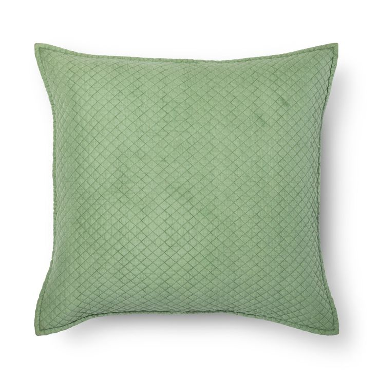 A soft hue and fabric will make the Washed Cotton Oversized Throw Pillow from Threshold a cozy spot. This square accent pillow has a small diamond pattern embedded into the texture.