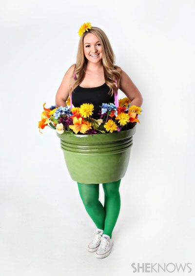 Flower pot costume | SheKnows.com | This would be cute filled with sunflowers and a bee on the headband!  Would be cute for kids too.