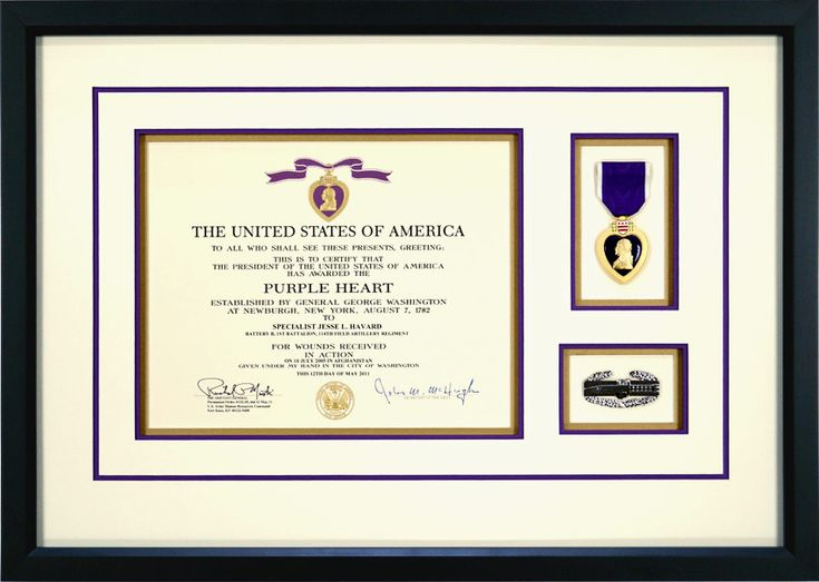This is an example of a custom framed Purple Heart Medal. It includes the signed award document stating the medal was received for wounds sustained in action. The Purple Heart Metal is framed with the citation document and a Combat Action Badge.