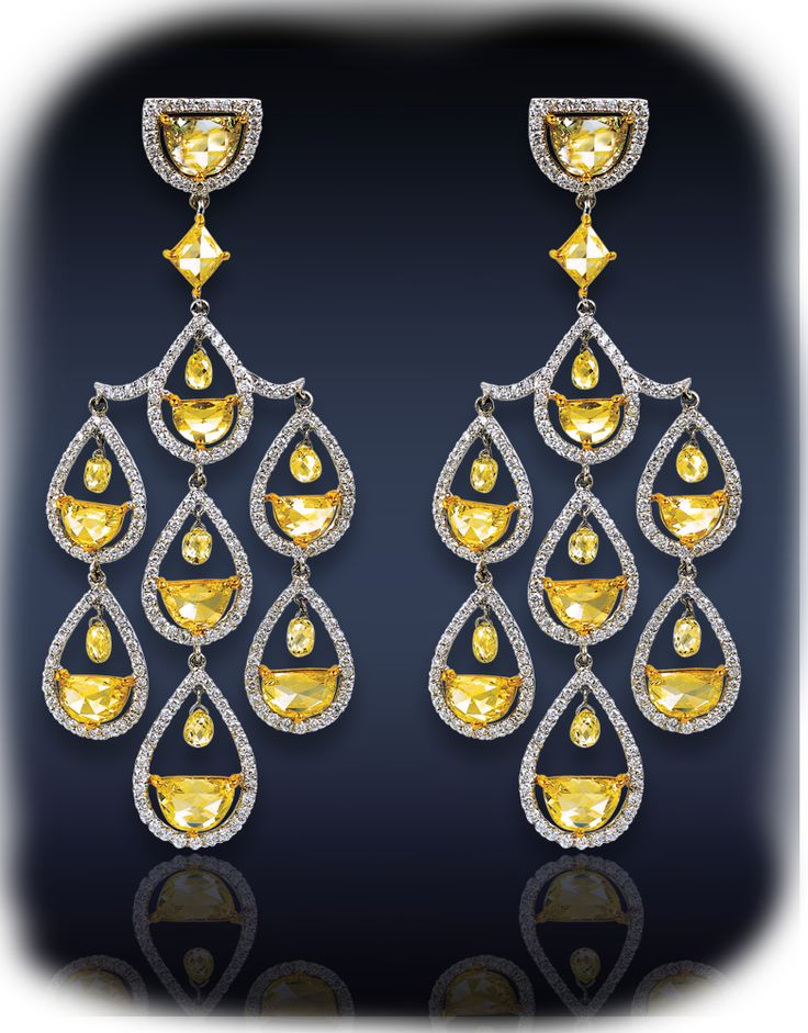 Beautifully Crafted Diamond Chandelier Earrings Featuring 9.19 Ct. Yellow Diamonds Framed By 2.32 Ct. Pave' Set White Diamonds Surmounted By 2.23 Ct. Briolette Cut Diamonds All Mounted In 18K White Gold.