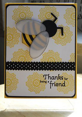 handmade card ... huge punch art bee with vellum leaves ... lluv the use of small doilies as flowers/honey comb ... yellow and white with black accents and layering for framing ...