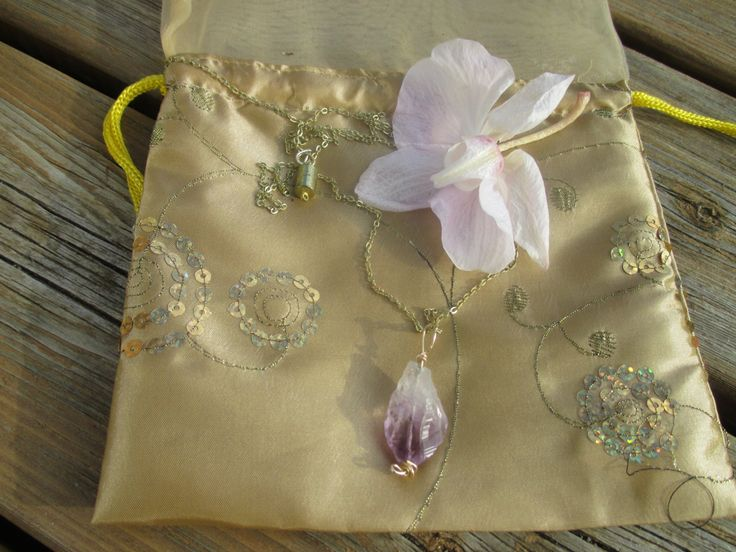 Raw amethyst pendant on gold chain by StayingGrounded on Etsy