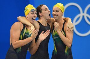 Brittany Elmslie, Emma McKeon and Bronte Campbell of Australia celebrate their new World Record in winning the women's 4x100m Freestyle…