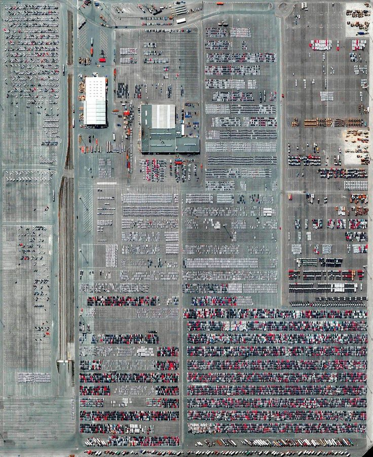 Automobiles and semi-trailer trucks are unloaded and shipped at the Port of Antwerp in Belgium. The facility moves approximately 1.2 million vehicles each year.  Instagram: http://bit.ly/2AGmePL  51.269956°, 4.228182°  Source imagery: DigitalGlobe