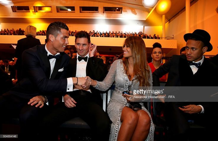 Ballon d'Or nominee Cristiano Ronaldo of Portugal and Real Madrid shakes hands with Antonella Roccuzzo as he sits with fellow nominees Lionel Messi of Argentina and Barcelona and Neymar of Brazil and Barcelona during the FIFA Ballon d'Or Gala 2015 at the Kongresshaus on January 11, 2016 in Zurich, Switzerland.