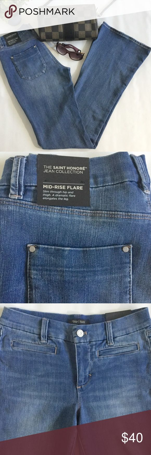"""WHBM Mid Rise Flare Jeans Size 2 Long.  Measures about 14.5"""" across the waistband 8.5"""" front rise 35.5"""" inseam 21.5"""" leg opening.  70% Cotton 28% Polyester 2% Spandex.  Wide Flare jeans with a mid rise.  It fits slim through the hip and thigh.  No trades. White House Black Market Jeans Flare & Wide Leg"""