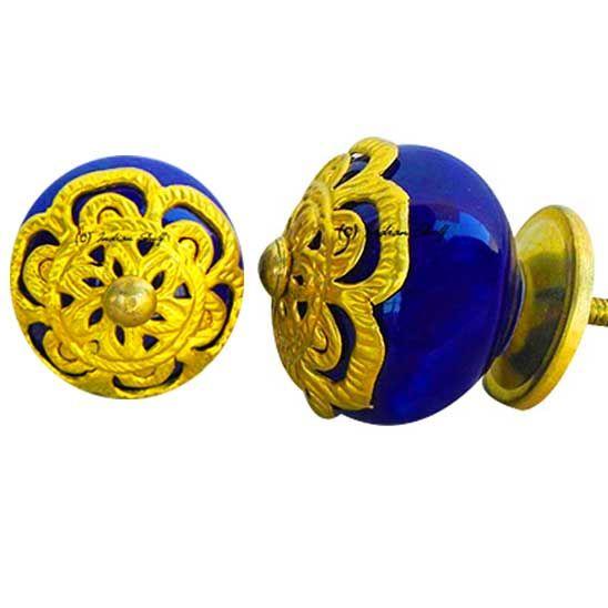 Stunning Golden embossed pattern knobs on striking blue color to dress up your furniture by #indianshelf #doorknobs http://goo.gl/mlmuZM