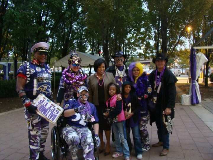 Baltimore Ravens Super Fans including the Baltimore Birdman posing for pictures with Baltimore City Mayor Stephanie Rawlings-Blake.
