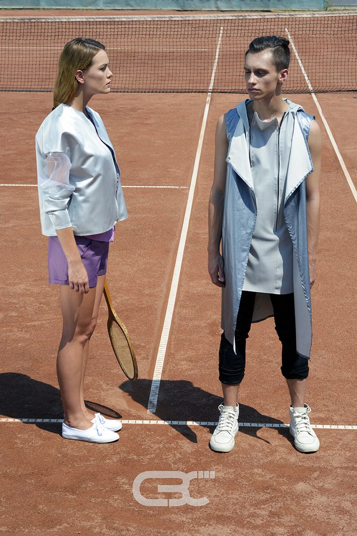 Lookbook: Her: Silver and sheer bomber jacket, purple shorts Him: Grey Hoodie, blue metallic vest, black pants Tennis court, sport, sportswear, fitness, trends, unisex, campaign photos. Order via facebook, pm or e-mail.