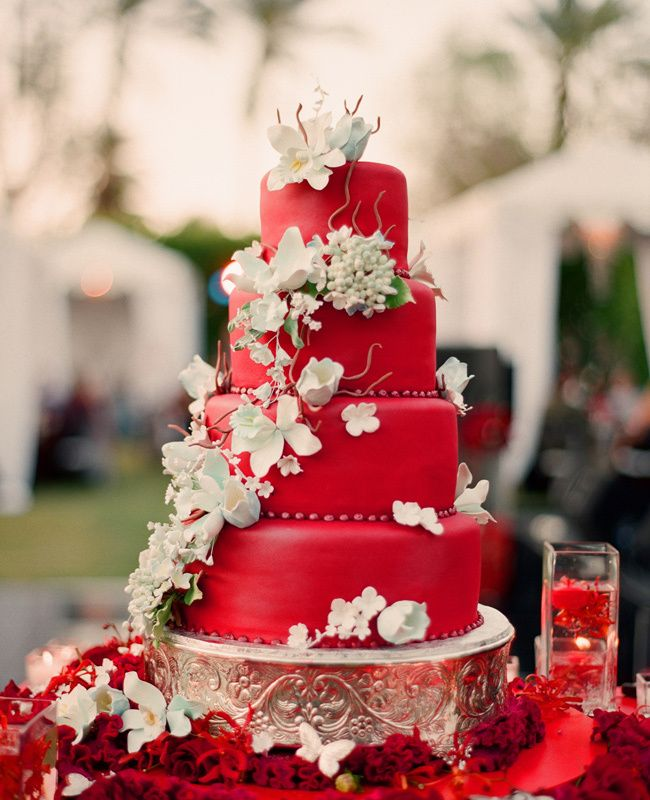 A red wedding cake covered in sugar flowers really stands out. (Best Wedding and Engagement Rings at www.brilliance.com)