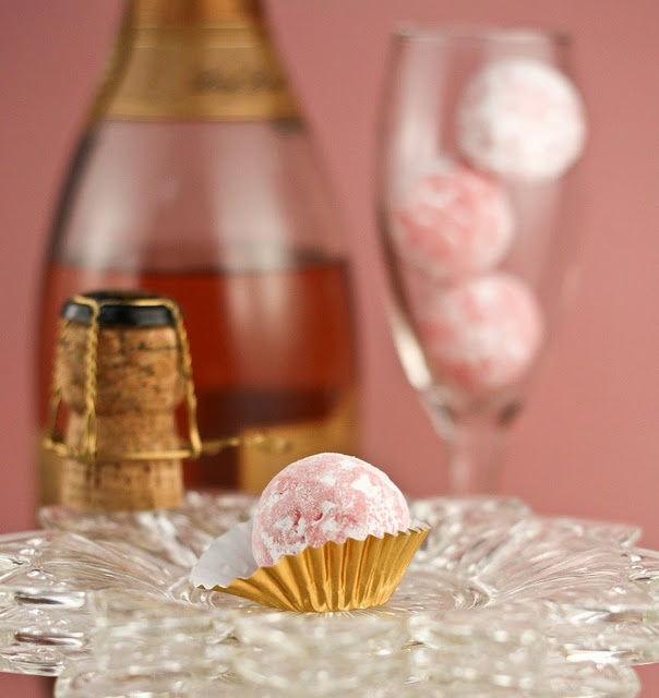 Pink Champagne Truffles - - 7 oz. high quality white chocolate, chopped  - 1 cup pink champagne such as KORBEL Brut Rosé  - 2 tbsp heavy cream  - 1 tsp red flavored gelatin (strawberry or raspberry)  - Confectioners sugar