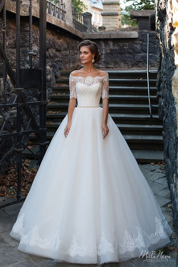 Forget cap sleeves and rock an off the shoulder illusion wedding dress instead! Three-quarter sleeves and unique detailing is all you need to stand out on your big day.