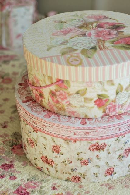 Chintz wallpaper covered hatboxes delight the eye and the quilted chintz coverlet is a treasure!
