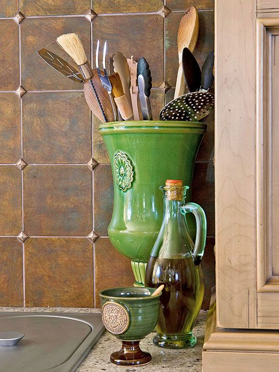 Storing in Style - Make your kitchen utensils just another part of the kitchen's decor. Instead of a clunky utensil organizer, go with a colorful vase that matches the kitchen's color scheme. Large utensils will be easily accessible and the vase contributes to the room's style while serving a practical purpose.