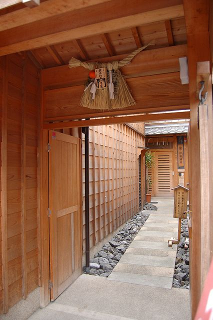 """Shimenawa (標縄・注連縄・七五三縄, literally """"enclosing rope"""") are lengths of braided rice straw rope used for ritual purification in the Shinto religion. They can vary in diameter from a few centimetres to several metres, and are often seen festooned with shide."""