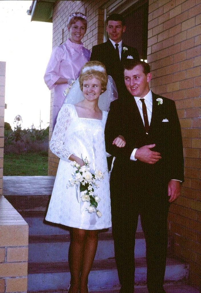 A short dress for an extremely happy bride. | 60 Adorable Real Vintage Wedding Photos From The '60s