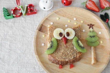 Christmas Birdy = Peanut Butter Toast, Banana, Raisins, Strawberty, & Kiwi