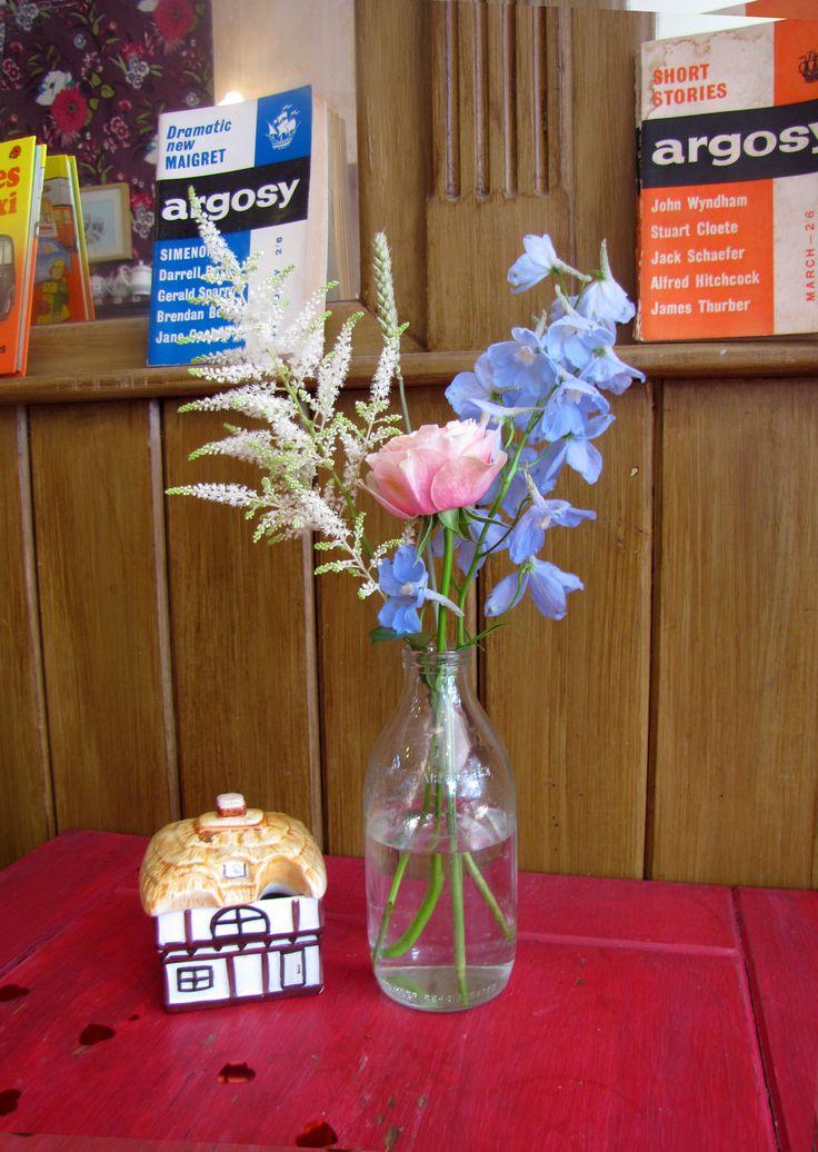 Rose, Delphinium and Astilbe milk bottle table centre piece