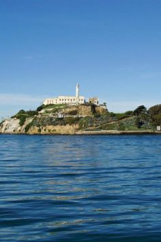 """Leaving on the ferry from Pier 33, visit Alcatraz, also known as """"The Rock,"""" where you'll stand in the prison cells of notorious criminals like Al Capone. There are daytime self-guided tours, as well as evening guided tours."""
