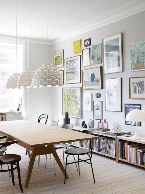 Full gallery wall in a modern dining space