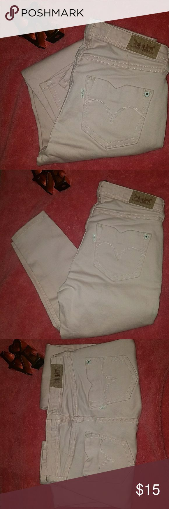 """Levi's 535  Skinny jean - Cropped Leggins Stretch denim  Mid rise  Super skinny leg  Button/zip fly closure; belt loops  Approx. 25"""" inseam, rolled  Cotton/elastane  Machine wash  Excellent Condition. Gently used.   Size : 24    Smoke and Pet free home  Any question please contact me   Thank you Levi's Jeans Ankle & Cropped"""