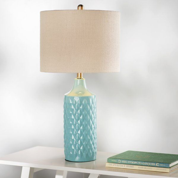 """Add a touch of texture to your table tops with the simply chic Melbourne Beach 26.6"""" H Table Lamp with Drum Shade, featuring a ceramic design with raised geometric details and a linen drum shade. Play up its chic, cosmopolitan look with abstract statues and weathered ikat rugs, then set out clean-lined chairs and a midcentury-inspired sofa to tie the whole look together in simple style. For a breezy look in the master bed room, let a pair of these lamps flank your bed, then arrange compl..."""