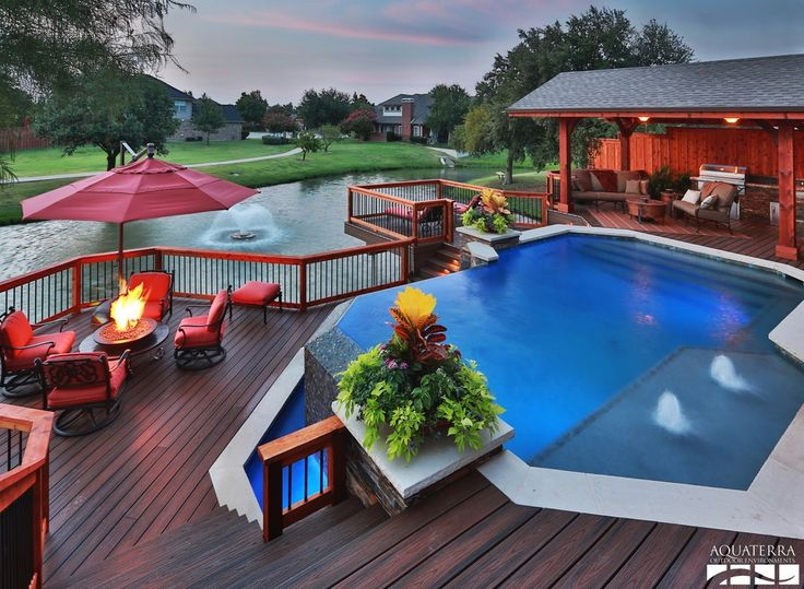 Craftsman Deck with Aquaterra Outdoor Environments Infinity Edge Pool, 10-foot Deluxe Offset Patio Umbrella