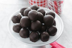 No candy-making skills required to make these no-bake chocolate-dipped peanut butter balls. They're perfect for festive gift-giving - the hard part will be having to give them all away!
