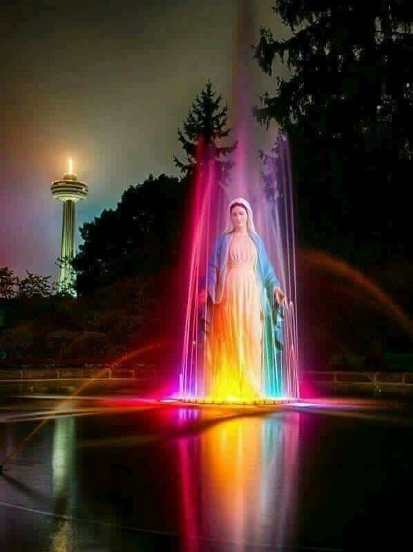 Blessed Virgin Mary surrounded by aura of colorful lights