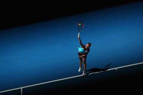 Romania's Simona Halep, the fourth seed in the women's draw, serves from the baseline towards Shelby Rogers
