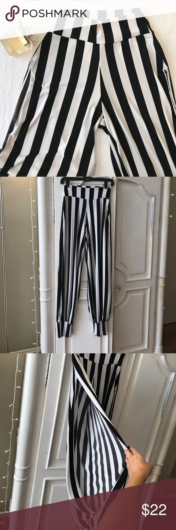 Sexy black and white striped beach pants! High-waisted, with cut-outs on the sides.  Super cute over a swimsuit or just by themselves with heels! Swim Coverups