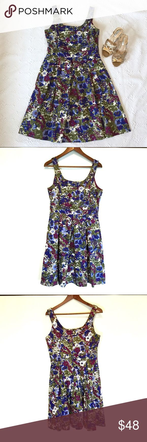 Donna Ricco beautiful floral dress EUC This Donna Ricco dress is amazingly beautiful.  96% cotton, 4% spandex. Great material that is cool to the touch, making it a perfect garden dress for summer. High waist shift. The dress has bra strap holder at the shoulder. Great looking dress! Donna Ricco Dresses Midi