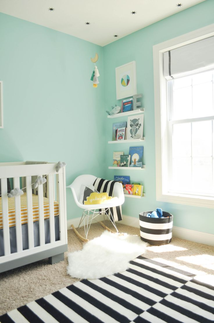 Modern and whimsical nursery with turquoise blue walls and black and white stripes || Live the Fancy Life