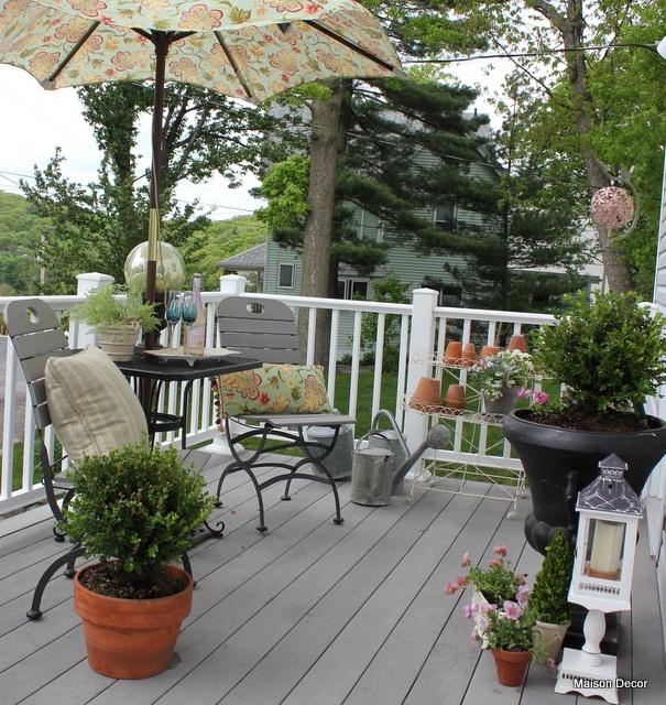 Garden themed patio featuring Pier 1 Angelique Umbrella and Pillow