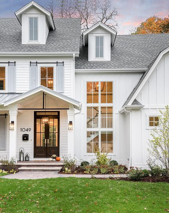 White Barn Style Home With Gray Shutters Display A Black Glass Front Paneled Double Door Wi Modern Farmhouse Exterior House Designs Exterior Farmhouse Exterior