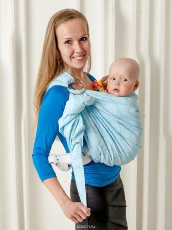 """Мамарада Слинг с кольцами Лилла размер М  — 1821р. ------------- Слинг с кольцами позволяет носить ребенка как горизонтально в положении """"Колыбелька"""" так и в вертикальном положении. В слинге в положении """"Колыбелька"""" малыш располагается точно так же, как у мамы на руках, что особенно актуально для новорожденного. Ткань слинга равномерно поддерживает спинку малыша по всей длине. Малышу комфортно и спокойно рядом с мамой. Мама в это время может заняться полезными делами или прогуляться. В…"""