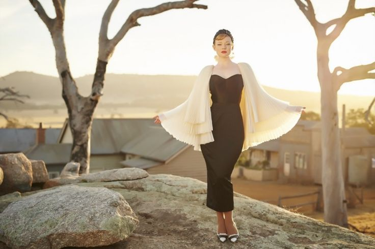 Gertrude (Sarah Snook) in black gown and cape in The Dressmaker (costume by Marion Boyce)