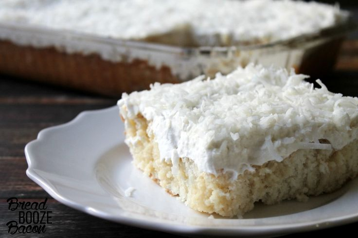 My Mom's Best Ever Coconut Cake is dessert heaven! Creamy, dreamy, tender cake topped with whipped cream is where it's at!