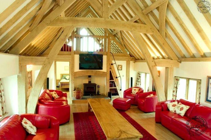 Cathedral style oak frame house - converted farm house by Carpenter Oak Ltd