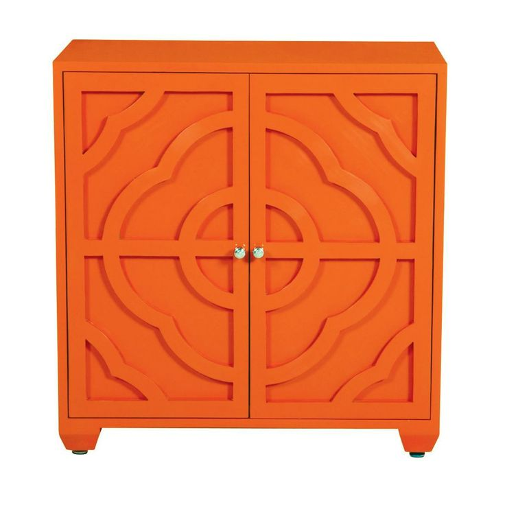 Decorative clover shaped relief detail on two door wooden chest with one adjustable shelf, hidden hinges and silver finished button knobs.  Shown in tangerine  Available colors- Cloud White, Ivory Sand, Charcoal Black, Young Grass, Tangerine, Tulip Red, Coral Reef, Navy, Sky Blue, Teal Plume, Dark Coffee, Pebble Gray  *Colors closely resemble, but may not be exact representations of actual finish.