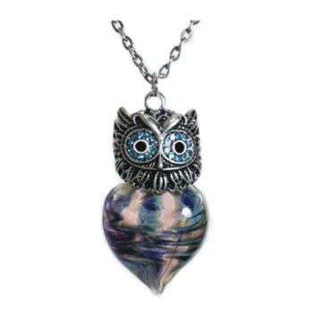 The Wise Owl Heart Cremation Jewelry has swirls of beautiful glass in a heart teardrop shape. Each urn is made with a technique called lamp working, with each piece being a special work of art. #cremation #jewelry