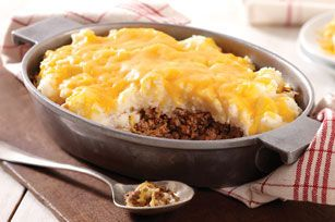 Ground beef, onion and steak sauce are simmered then spooned into a casserole, topped with cheesy mashed potatoes and baked for a hearty entrée.