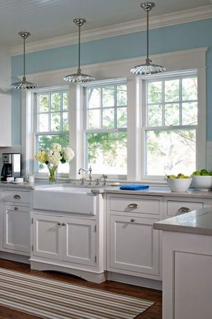 Cottage kitchen with hardwood floors standard height for House plans with kitchen sink window