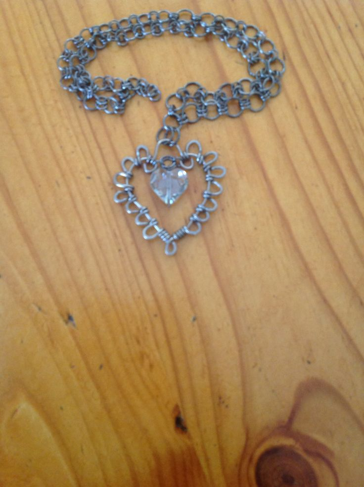Wire wrapped heart with smoky crystal on a handmade chain.