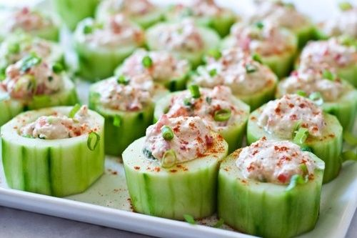 Cucumber cups stuffed with spicy crab-make it lunch by cutting cucumber in half, hollowing it out, and filling it. Use lowfat cream cheese and sour cream.... Or change the filling to make it more Paleo.
