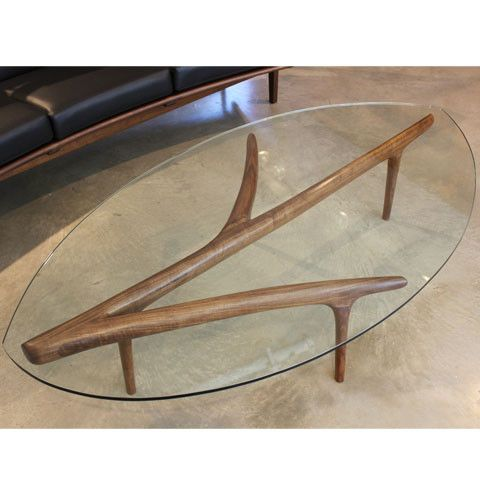Leaf Center Table by Seiji Kuwabara.  Glass topped center table with a warm hand carved walnut base.  Available at Kozai Modern  $3,200